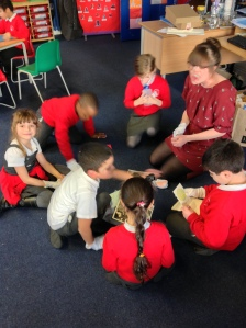 In small groups, taking a look at the NUWT archives with their white gloves on.  One of my favourite bits of the workshop was when one of the boys was taking a look at an old ticket from a demonstration at Royal Albert Hall, paused, and asked '... Are these from the ladies we learned about?!'  The year 2s had also been learning about London landmarks and were quite excited to see 'Royal Albert Hall'.